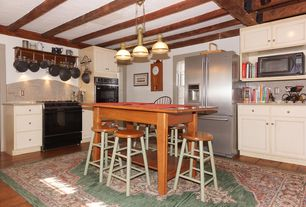 Country Kitchen with Simple granite counters, Standard height, Breakfast bar, Exposed beam, Kitchen island, Simple Granite