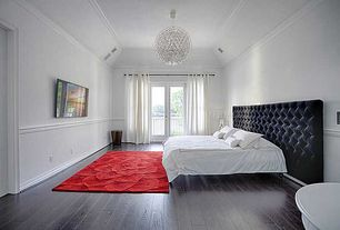 Modern Master Bedroom with French doors, Chair rail, Crown molding, Chandelier, Hardwood floors