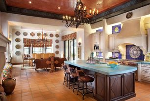 Eclectic Great Room with French doors, can lights, Fireplace, Standard height, Wall sconce, Cement fireplace, Chandelier
