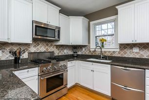 Traditional Kitchen with Complex granite counters, Flat panel cabinets, double-hung window, Slate Tile, U-shaped, gas range