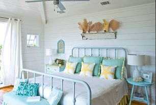 Cottage Guest Bedroom with Built-in bookshelf, Horizontal wood plank wall, Hardwood floors, Ceiling fan, Sea fan