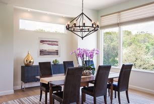 Contemporary Dining Room with Hardwood floors, Chandelier, High ceiling