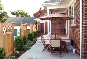 Traditional Patio with Fence, Glass panel door, double-hung window, exterior stone floors, Pathway