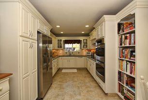 Traditional Kitchen with Stone Tile, complex granite tile floors, U-shaped, Limestone Tile, Raised panel, Flush, Custom hood