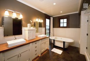 Craftsman Master Bathroom with Crown molding, Concrete floors, Chair rail, frameless showerdoor, Flat panel cabinets