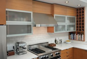 Contemporary Kitchen with Standard height, gas range, Flush, can lights, Corian counters, Glass panel, Wall Hood, Subway Tile