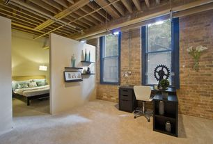 Rustic Home Office with interior brick, double-hung window, Exposed beam, Built-in bookshelf, Standard height, Carpet