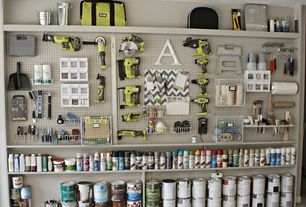 Traditional Garage with Triton duraboard pegboard, Built-in bookshelf, Ryobi Tool Bag, Concrete floors