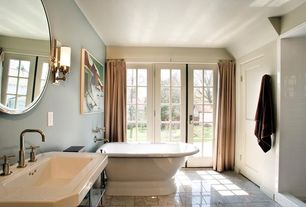 Traditional Master Bathroom with Wall sconce, French doors, Console sink, Master bathroom, Bathtub, stone tile floors