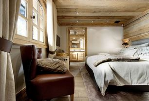 Rustic Master Bedroom with Hardwood floors, Crown molding, double-hung window, French doors, Standard height, can lights