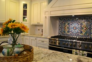 Traditional Kitchen with full backsplash, Standard height, mexican tile backsplash, Flat panel cabinets, L-shaped, can lights