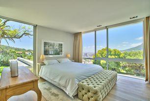 Traditional Master Bedroom with Hand-Woven Grey Wool and Art Silk Area Rug, Hardwood floors