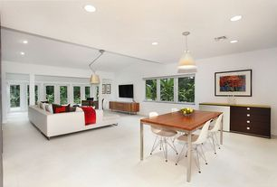 Great Room with can lights, Standard height, Exposed beam, Pendant light, Columns, Casement, Paint, Carpet