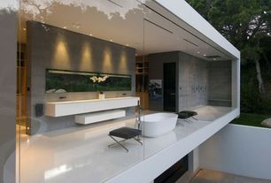 Contemporary Master Bathroom with Master bathroom, Corian counters, limestone floors, Standard height, Vessel sink