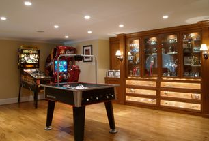 Traditional Game Room with Wall sconce, Built-in bookshelf, Hardwood floors