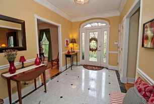 Traditional Entryway with Crown molding, Transom window, simple marble tile floors, Chair rail, French doors, flush light