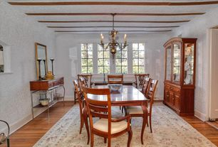 Traditional Dining Room with Hardwood floors, Chandelier, Standard height, Casement, Exposed beam