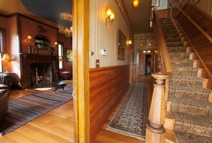 Traditional Staircase with High ceiling, Hardwood floors, interior wallpaper, curved staircase, Wainscotting