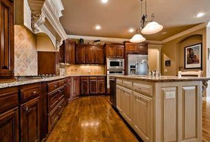 Traditional Kitchen with Pendant light, Undermount sink, Breakfast bar, Raised panel, Simple granite counters, Crown molding