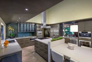 Contemporary Kitchen with U-shaped, Corian counters, European Cabinets, Kitchen island, Wine refrigerator, Cathedral ceiling