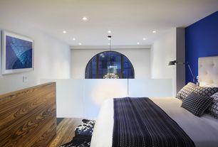 Contemporary Master Bedroom with Exotic Black & White Cowhide Rug, Dark Bronze Larsen Metal Task Lamp, Laminate floors