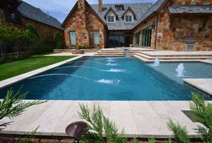 Traditional Swimming Pool with double-hung window, Fountain, Outdoor kitchen, Pool with hot tub, French doors