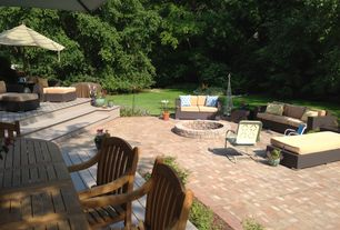Traditional Patio with Raised beds, exterior stone floors, Teak outdoor furniture, Fire pit, Pathway
