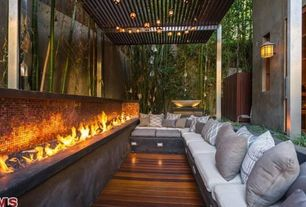 Contemporary Deck with Fire pit, Custom fire wall feature, Smart solar san rafael 20 light string lantern set, Trellis, Fence
