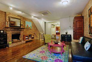Eclectic Living Room with flush light, brick fireplace, Hardwood floors, Standard height, Pendant light, Fireplace