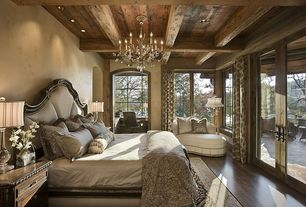 Traditional Master Bedroom with Arched window, French doors, Exposed beam, 10-light Traditional Chandelier, Chandelier