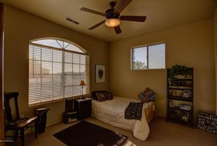 Traditional Guest Bedroom with Carpet, Arched window, Ceiling fan