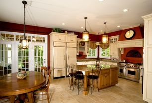 Country Kitchen with Raised panel, Undermount sink, limestone tile floors, Transom window, Kitchen island, French doors