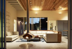Contemporary Living Room with Exposed wood ceiling, High ceiling, Wall sconce, Built-in bookshelf, Fire orb, Carpet