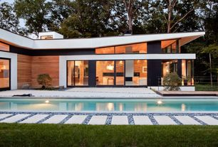 Modern Swimming Pool with exterior tile floors, French doors, Pathway