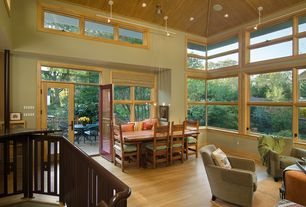 Craftsman Living Room with Transom window, Built-in bookshelf, Casement, Exposed beam, picture window, High ceiling