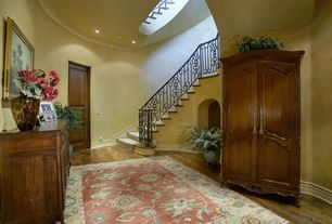 Traditional Hallway with Crown molding, Hardwood floors, Built-in bookshelf