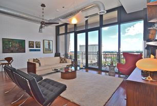 Modern Living Room with Built-in bookshelf, Pendant light, interior brick, Hardwood floors, Columns, Ceiling fan