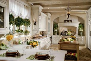 Traditional Kitchen with Kitchen island, Inset cabinets, Casement, wall oven, Undermount sink, Exposed beam, Corian counters