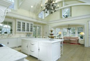 Traditional Kitchen with Chandelier, Complex marble counters, Breakfast bar, Cathedral ceiling, U-shaped, Arched window