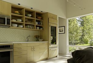 Contemporary Kitchen with Corian counters, Flush, European Cabinets, Built-in bookshelf, Undermount sink, High ceiling
