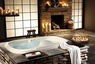 Rustic Master Bathroom with Frosted glass window, Stacked stone fireplace, Natural stone surround, Chandelier