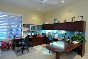Traditional Home Office with picture window, Carpet, can lights, Ceiling fan, Built-in bookshelf, Standard height