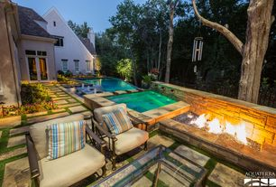 Traditional Patio with Fire pit, Fence, French doors, exterior stone floors