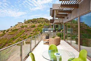 Modern Deck with picture window, Deck Railing, Trellis, Pathway, exterior concrete tile floors, exterior tile floors