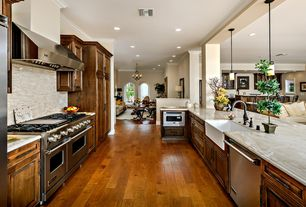 Mediterranean Kitchen with Columns, Complex marble counters, U-shaped, Raised panel, Ceramic Tile, Pendant light