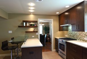 Contemporary Kitchen with Custom hood, U-shaped, Glass mounted breakfast bar, European Cabinets, limestone tile floors, Flush