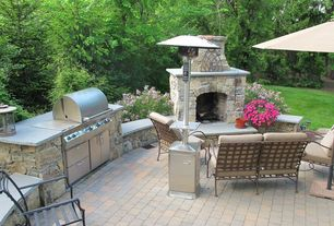 Traditional Patio with outdoor pizza oven, Raised beds, exterior stone floors, Outdoor kitchen