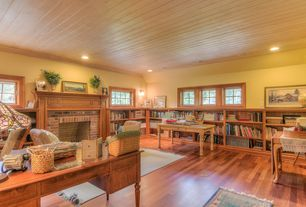 Craftsman Home Office with Hardwood floors, Built-in bookshelf, Wall sconce, Crown molding