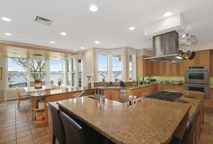 Contemporary Kitchen with Corian counters, L-shaped, Flat panel cabinets, Ceramic Tile, slate tile floors, Breakfast bar