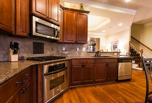 Traditional Kitchen with L-shaped, Crown molding, Hardwood floors, Raised panel, Undermount sink, Complex granite counters